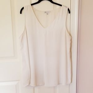 White sleeveless v neck blouse